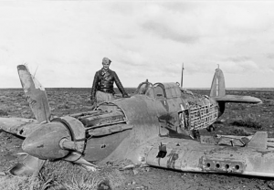 Image of a Hurricane lying destroyed in a field.