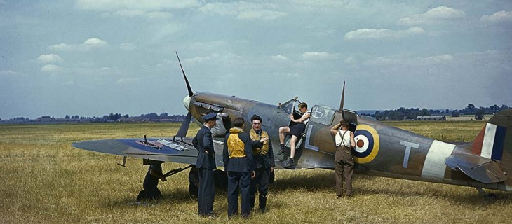 A Spitfire surrounded by crew